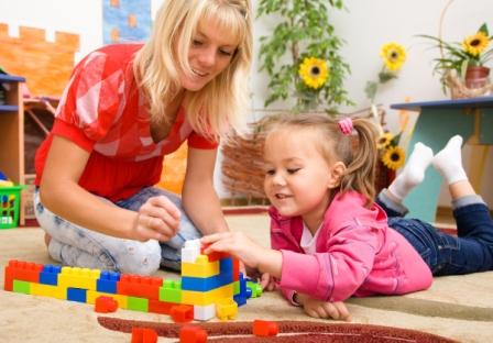 bigstock-Teacher-and-child-are-playing--26401664 (2)