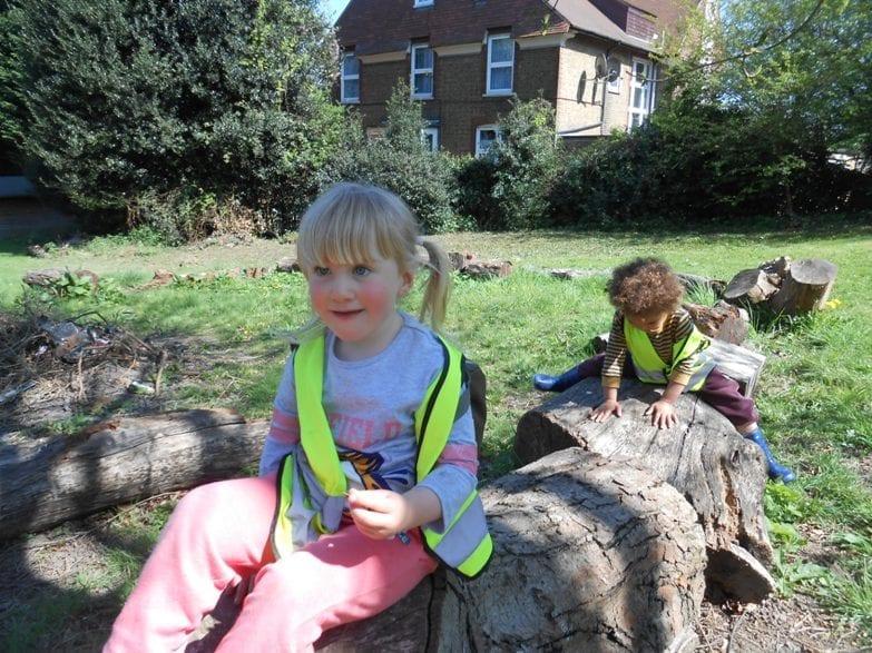 children on log